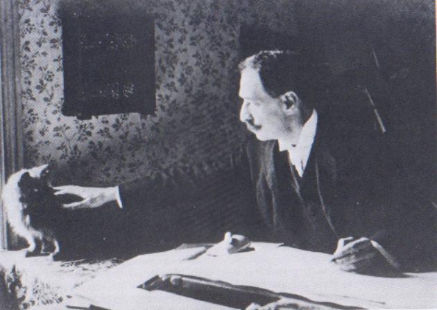 Louis_Wain_at_his_drawing_table_1890